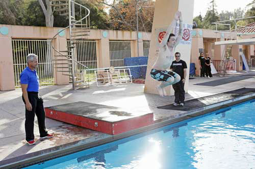 "<div class=""meta image-caption""><div class=""origin-logo origin-image ""><span></span></div><span class=""caption-text"">SPLASH - ""Splash"" marks the first time 10 celebrities will train and compete in regulation platform and springboard diving at dizzying heights in front of a weekly poolside audience. Leading up to the competition, the world's most decorated and medaled diving legend, Greg Louganis, will give each celebrity weeks of training. Each dive will be critiqued by the judges, London Olympic U.S. Gold medalist David Boudia and Australian Olympic athlete and USA Dive Team director Steve Foley. ""Splash"" premieres TUESDAY, MARCH 19 (8:00-9:00 p.m., ET) on The ABC Television Network. (ABC/KELSEY MCNEAL) GREG LOUGANIS, DRAKE BELL (Photo/Kelsey McNeal)</span></div>"