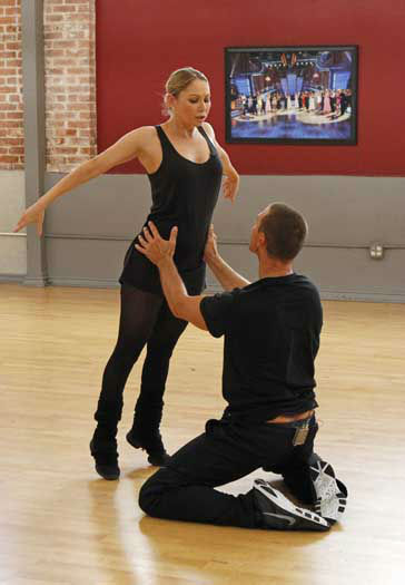 "<div class=""meta image-caption""><div class=""origin-logo origin-image ""><span></span></div><span class=""caption-text"">DANCING WITH THE STARS - REHEARSALS - This season's dynamic lineup of stars  will perform for the first time on live national television with their professional partners during the two-hour season premiere of ""Dancing with the Stars,"" MONDAY, MARCH 18 (8:00-10:01 p.m., ET) on the ABC Television Network. (ABC/Rick Rowell) KYM JOHNSON, INGO RADEMACHER (Photo/Rick Rowell)</span></div>"