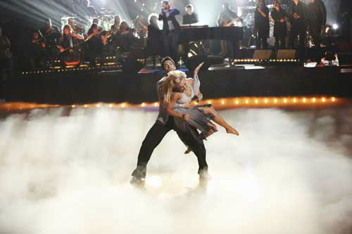 "<div class=""meta image-caption""><div class=""origin-logo origin-image ""><span></span></div><span class=""caption-text"">DANCING WITH THE STARS THE RESULTS SHOW - ""Episode 1602A"" - On TUESDAY, MARCH 26, one couple will face the first nail biting elimination on the season premiere of ""Dancing with the Stars the Results Show"" (9:00-10:01 p.m., ET). The show will feature a musical performance by signer Josh Groban, who is set to perform his current single, ""Brave,"" with an 18-piece band accompanied by ""Dancing with the Stars"" alumni Chelsie Hightower and Dmitry Chaplin. Adding to the excitement, acclaimed Swedish duo Icona Pop will perform their hit song, ""I Love It."" The results show will feature a spectacular opening performance by this season's pros and Troupe dancers. (ABC/Adam Taylor) DMITRY CHAPLIN, CHELSIE HIGHTOWER (Photo/Adam Taylor)</span></div>"