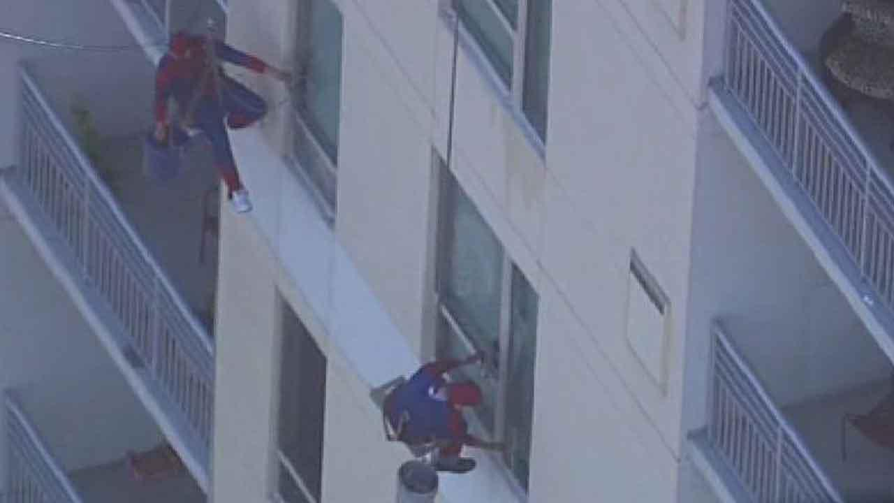 A window washing company had its workers dress up as Spider-man as they did their job on the Memorial by Windsor senior tower