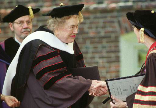Master chef and author Julia Child, center, is congratulated after receiving an honorary doctorate of humane letters from Brown University in Providence, R.I., at graduation ceremonies, Monday, May 29, 2000. &#40;AP Photo&#47;Michael Dwyer&#41; <span class=meta>(AP Photo&#47; MICHAEL DWYER)</span>