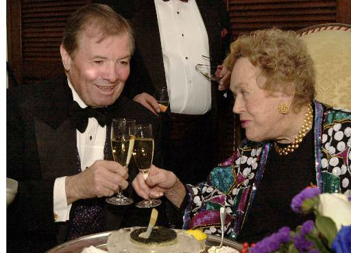 Chef Jaques Pepin, left, and culinary legend Julia Child share a toast before Child was to receive the Legion of Honor, Sunday, Nov. 19, 2000 in Boston. The award is the highest honor bestowed by the French Government in recognition of outstanding military and civil services to the French nation. &#40;AP Photo&#47;Michael Dwyer&#41; <span class=meta>(AP Photo&#47; MICHAEL DWYER)</span>