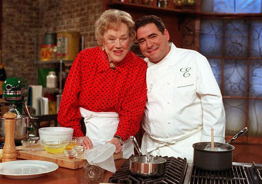 FILE-This Nov. 17, 2000 file photo shows television chefs Julia Child and Emeril Lagasse  shown on the set of Lagasse&#39;s show in New York. More so than the tools and techniques she popularized, Child&#39;s most lasting legacy may be her spirit and sense of humor. That was the conclusion of several chefs and food magazine editors asked to describe Child&#39;s memorable contributions to American home cooking as a new movie about her life is about to open. &#40;AP Photo&#47;Jim Cooper,File&#41; <span class=meta>(AP Photo&#47; JIM COOPER)</span>