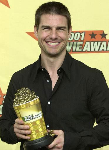 "<div class=""meta image-caption""><div class=""origin-logo origin-image ""><span></span></div><span class=""caption-text"">People's Sexiest Man Alive 1990: Tom Cruise. Actor Tom Cruise shows off his award for best male performance for his work in ""Mission: Impossible II"" at the 2001 MTV Movie Awards in Los Angeles, Saturday, June 2, 2001.  The winners for the awards show, scheduled to air June 7, were chosen through a national poll of MTV viewers.  (AP Photo/ KEVORK DJANSEZIAN)</span></div>"