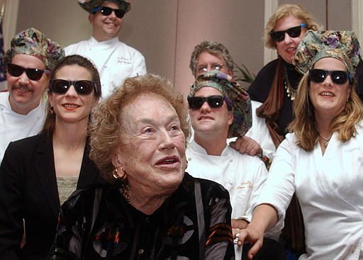 Boston area chefs in funny hats and sunglasses surround Julia Child, front, at a farewell dinner in her honor Wednesday, Nov. 7, 2001, in Cambridge, Mass. Child, who popularized French cooking in the U.S., is moving back to her native California. &#40;AP Photo&#47;Michael Dwyer&#41; <span class=meta>(AP Photo&#47; MICHAEL DWYER)</span>