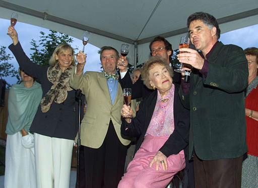 ** ADVANCE FOR WEEKEND EDITIONS AUG. 15-18 **Julia Child, second from right, gets a 90th birthday toast from winemaker Garen Staglin, right, during a birthday celebration at Copia, the American Center for Wine, Food, and the Arts, in Napa, Calif., Aug. 3, 2002. Child&#39;s longtime television colleague chef and author Jacques Pepinthird from left, also toasts Child. Child, who more than 40 years ago began educating our palates about the wonders of French cooking, turns 90 on Thursday, Aug. 15. &#40;AP Photo&#47;Eric Risberg&#41; <span class=meta>(AP Photo&#47; ERIC RISBERG)</span>