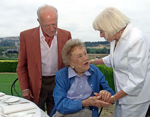 **  ADVANCE FOR WEEKEND OF AUGUST 17-18 ** Julia Child, center, is given 90th birthday wishes from winemaker Robert Mondavi, left, and his wife Margrit Biever Mondavi, right, during a birthday brunch at the Domaine Carnerors winery in Napa, Calif., Saturday, Aug. 3, 2002. The secret to a robust life? &#34;Eat well and drink well,&#34; says Julia Child, &#34;everything in moderation _ and never snack.&#34; Child, who more than 40 years ago began educating our palates about the wonders of French cooking, turns 90 on Thursday. &#40;AP Photo&#47;Eric Risberg&#41; <span class=meta>(AP Photo&#47; ERIC RISBERG)</span>