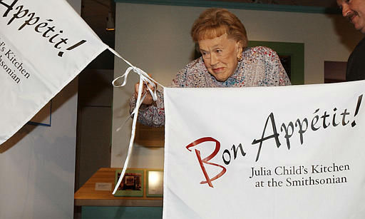Chef Julia Child pulls on apron strings to open her kitchen exhibition at the Smithsonian&#39;s National Museum of American History in  Washington, Monday, Aug. 19, 2002.  Child donated her entire kitchen to the institution after deciding to move to California,  from her Cambridge, Mass., home. Child became an official part of the national heritage on Monday, belatedly celebrating her 90th birthday at the opening. {AP Photo&#47;Dennis Cook&#41; <span class=meta>(AP Photo&#47; DENNIS COOK)</span>