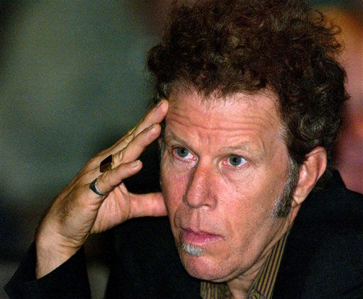 ** FILE ** Singer Tom Waits listens as musicians testify before a state Senate panel about record label accounting practices, in Los Angeles, in a Tuesday, Sept. 24, 2002 photo.  Grammy Award-winning singer Tom Waits has settled a lawsuit in which he claimed an automaker and ad agency violated his rights by imitating him in TV commercials, his lawyer said Friday. <span class=meta>(AP Photo&#47; LUCY NICHOLSON)</span>