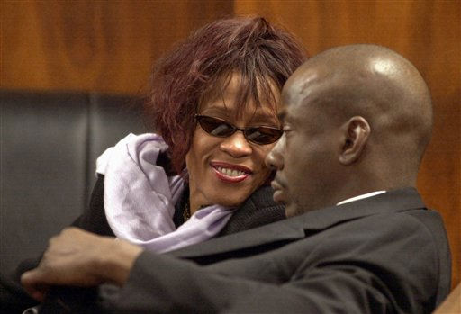"<div class=""meta image-caption""><div class=""origin-logo origin-image ""><span></span></div><span class=""caption-text"">FILE - In this Nov. 25, 2002, file photo, singer Whitney Houston, left, smiles at her husband, singer Bobby Brown, during a court hearing  in Dekalb County State Court in Decatur, Ga. Publicist Kristen Foster said, Saturday, Feb. 11, 2012, that singer Whitney Houston has died at age 48.    (AP Photo/ ERIK S. LESSER)</span></div>"