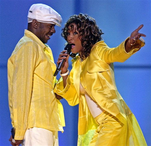 FILE - In this May 23, 2003 file photo, Whitney Houston, right, and her husband, Bobby Brown, perform during the &#34;VH1 Divas&#34; duets show in Las Vegas. Whitney Houston, who reigned as pop music&#39;s queen until her majestic voice and regal image were ravaged by drug use, has died, Saturday, Feb. 11, 2012. She was 48. &#40;AP Photo&#47;Joe Cavaretta, File&#41; <span class=meta>(AP Photo&#47; JOE CAVARETTA)</span>