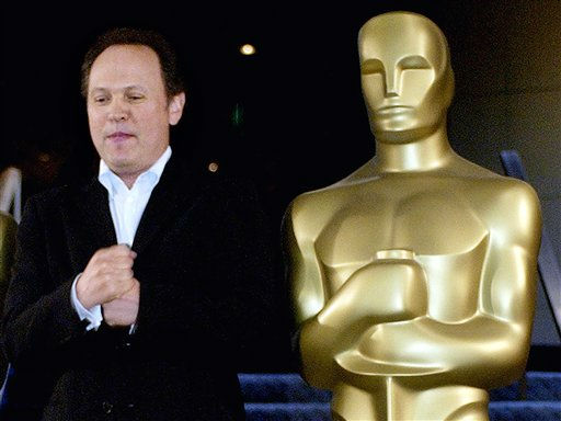 **FILE**Oscars host Billy Crystal imitates an Oscar statue&#39;s pose at a news conference introducing him as the host of the 76th Academy Awards, at the Academy of Motion Picture Arts and Sciences headquarters in Beverly Hills, Calif., on Sept. 24, 2003. Crystal told the Los Angles Daily News that he passed on the 2006 Oscar hosting job that went to Comedy Central&#39;s Jon Stewart because his one-man stage show was consuming his attention. &#40;AP Photo&#47;Reed Saxon&#41; <span class=meta>(AP Photo&#47; REED SAXON)</span>
