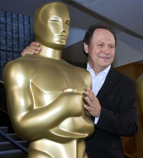 Actor and comedian Billy Crystal poses with an Oscar statue after he is named the host of the 76th Academy Awards, at a news conference at the Academy of Motion Picture Arts and Sciences headquarters in Beverly Hills, Calif., Wednesday, Sept. 24, 2003. The Oscars will be presented on Feb. 29, 2004.  &#40;AP Photo&#47;Reed Saxon&#41; <span class=meta>(AP Photo&#47; REED SAXON)</span>