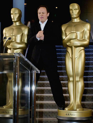 Actor&#47;comedian Billy Crystal stands on two Oscar statues, mimicking their pose, as he arrives at a news conference where he is announced as the host of the 76th Academy Awards, at the Academy of Motion Picture Arts and Sciences headquarters in Beverly Hills, Calif., Wednesday, Sept. 24, 2003.  The Oscars will be presented on Feb. 29, 2004.  &#40;AP Photo&#47;Reed Saxon&#41; <span class=meta>(AP Photo&#47; REED SAXON)</span>