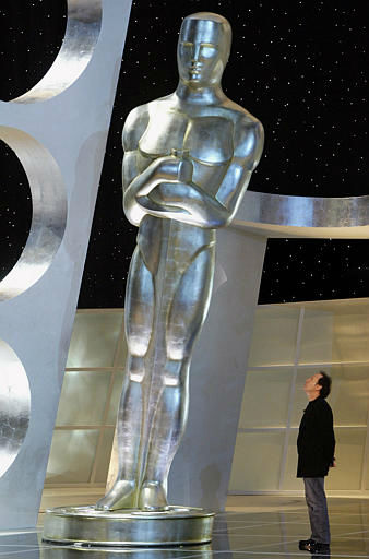 Oscar host Billy Crystal looks up at a giant leaning Oscar statue on the stage of the Kodak Theatre during rehearsal for the 76th annual Academy Awards Friday, Feb. 27, 2004, in Los Angeles.  The Oscars are on Sunday, Feb. 29. &#40;AP Photo&#47;Kevork Djansezian&#41; <span class=meta>(AP Photo&#47; KEVORK DJANSEZIAN)</span>