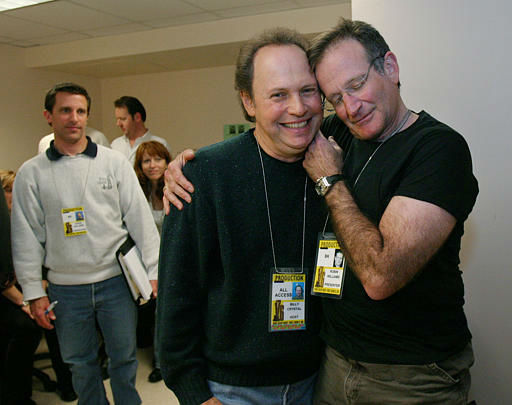 Oscar host Billy Crystal, center, and presenter Robin Williams, right, joke around after a writers&#39; meeting for the 76th annual Academy Awards at the Kodak Theatre Saturday, Feb. 28, 2004, in Los Angeles. &#40;AP Photo&#47;Kevork Djansezian&#41; <span class=meta>(AP Photo&#47; KEVORK DJANSEZIAN)</span>