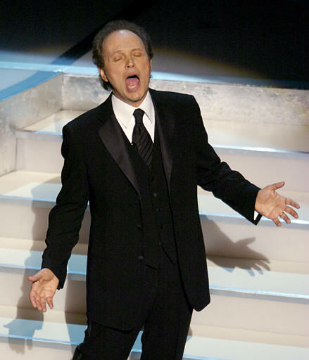 "<div class=""meta image-caption""><div class=""origin-logo origin-image ""><span></span></div><span class=""caption-text"">Host Billy Crystal sings during his monologue to open the 76th annual Academy Awards telecast Sunday, Feb. 29, 2004, in Los Angeles. (AP Photo/Mark J. Terrill) (AP Photo/ MARK J. TERRILL)</span></div>"
