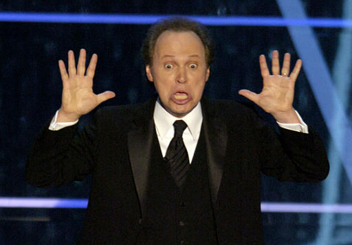 "<div class=""meta ""><span class=""caption-text "">Host Billy Crystal performs his monologue to open the 76th annual Academy Awards telecast Sunday, Feb. 29, 2004, in Los Angeles. (AP Photo/Mark J. Terrill) (AP Photo/ MARK J. TERRILL)</span></div>"