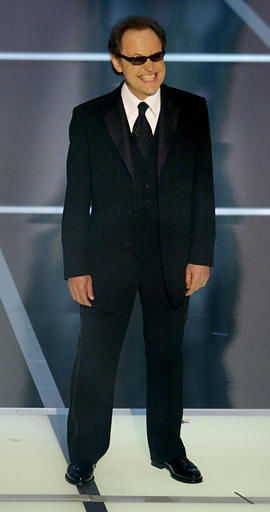 "<div class=""meta image-caption""><div class=""origin-logo origin-image ""><span></span></div><span class=""caption-text"">Host Billy Crystal performs his monologue to open the 76th annual Academy Awards telecast Sunday, Feb. 29, 2004, in Los Angeles. (AP Photo/Mark J. Terrill) (AP Photo/ MARK J. TERRILL)</span></div>"