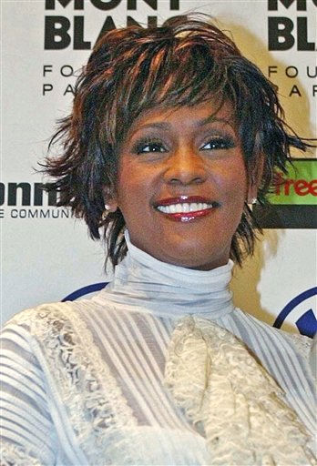 **FILE**Singer Whitney Houston poses prior to getting the World Artist Award for Lifetime Achievement  in Hamburg&#39;s Congress Center, in northern Germany, on June 9, 2004.  Houston has filed for divorce from her husband Bobby Brown, her publicist told The Associated Press on Wednesday, Sept. 13, 2006.&#40;AP Photo&#47;Christof Stache, pool&#41; <span class=meta>(AP Photo&#47; CHRISTOF STACHE)</span>