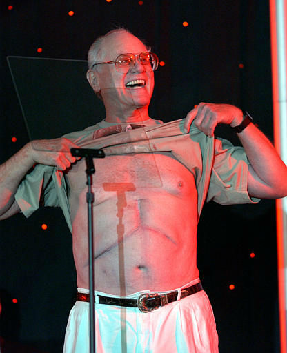 Actor Larry Hagman bares his chest to show off his scar from his liver transplant surgery at the opening ceremonies of the 2004 U.S. Transplant Games. in Minneapolis, Wednesday, July 28, 2004. Hagman, who played J.R. Ewing on the TV series, &#34;Dallas&#34; had life-saving liver transplant in 1995 and has served as honorary chairman of the National Kidney Foundation U.S. Transplant Games since 1996.   <span class=meta>(AP Photo&#47; ERIC MILLER)</span>