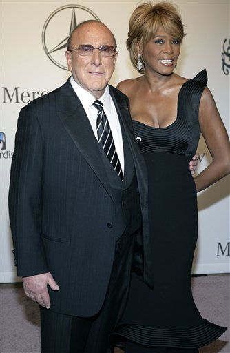 FILE - In this Oct. 28, 2006 file photo, Whitney Houston, right, and music producer Clive Davis arrive at the 17th Carousel of Hope Ball benefiting the Barbara Davis Center for Childhood Diabetes in Beverly Hills, Calif. Whitney Houston, who reigned as pop music&#39;s queen until her majestic voice and regal image were ravaged by drug use, has died, Saturday, Feb. 11, 2012. She was 48. &#40;AP Photo&#47;Matt Sayles, File&#41; <span class=meta>(AP Photo&#47; MATT SAYLES)</span>