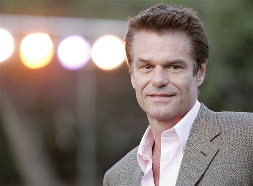 "<div class=""meta image-caption""><div class=""origin-logo origin-image ""><span></span></div><span class=""caption-text"">People's Sexiest Man Alive 1987: Harry Hamlin. Actor Harry Hamlin arrives at the grand opening of Tori Spelling and Dean McDermott's Bed and Breakfast in Fallbrook, Calif. on Saturday, March 3, 2007.  (AP Photo/ DAN STEINBERG)</span></div>"