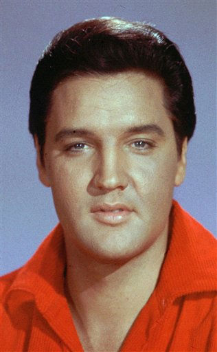 "<div class=""meta image-caption""><div class=""origin-logo origin-image ""><span></span></div><span class=""caption-text"">FILE - This undated file photo shows Elvis Presley. Every year, thousands of Elvis devotees flock to Memphis to remember the singer's death on Aug. 16, 1977. The main event of ""Elvis Week"" is the solemn candlelight vigil at Graceland, his longtime home, at midnight Tuesday, Aug. 16, 2011. (AP Photo, File) (AP Photo/ CJC XJRG FM SH**NY** SBH**NY**)</span></div>"