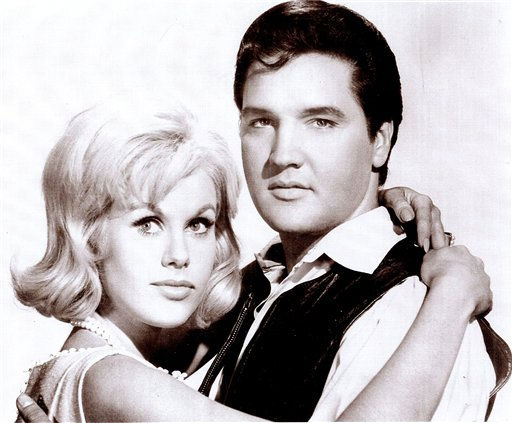 Suzanna Leigh embraces Elvis Presley in a publicity photo from the 1966 film &#34;Paradise, Hawaiian Style.&#34; Leigh was one of Presley&#39;s many female co-stars and is organizing a gathering of actors, actresses and others who worked on Presley&#39;s movies. The gathering is scheduled to be held in Memphis, Tenn. to mark the 30th anniversary of Presley&#39;s death. &#40;AP Photo&#47;courtesy Suzanna Leigh&#41; <span class=meta>(AP Photo&#47; Anonymous)</span>