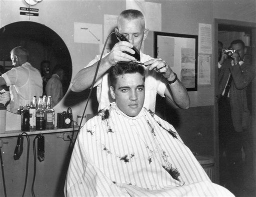 ** FILE ** In this March 1958 file photo, singer Elvis Presley gets his hair cut before entering the Army at Fort Chaffee in Barling, Ark. According the the U.S. Army, Presley entered the service March 24, 1958, at Fort Chaffee Reception Station. &#40;AP Photo&#47;File&#41; <span class=meta>(AP Photo&#47;  PDS **NY**)</span>
