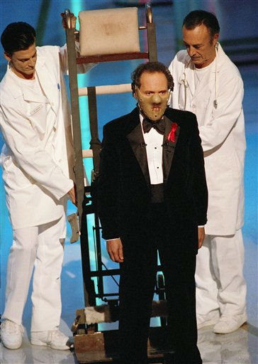 Oscar host Billy Crystal dons a Hannibal the Cannibal mask  at the opening segment of  64th Annual Academy Awards Monday, March 30, 1992 in Los Angeles.   Actor Anthony Hopkins is nominated for actor in a leading role this year for his portrayal of Dr.  Hannibal Lecter in &#34;The Silence of the Lambs.&#34; &#40;AP Photo&#47;Craig Fujii&#41; <span class=meta>(AP Photo&#47; Craig Fujii)</span>