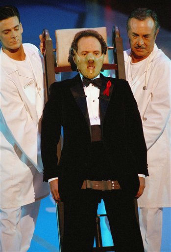 "<div class=""meta image-caption""><div class=""origin-logo origin-image ""><span></span></div><span class=""caption-text"">Oscar host Billy Crystal dons a Hannibal the Cannibal mask  at the opening segment of  64th Annual Academy Awards Monday, March 30, 1992 in Los Angeles.   Actor Anthony Hopkins is nominated for actor in a leading role this year for his portrayal of Dr.  Hannibal Lecter in ""The Silence of the Lambs."" (AP Photo/Craig Fujii) (AP Photo/ Craig Fujii)</span></div>"