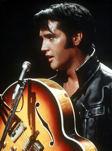 "<div class=""meta ""><span class=""caption-text "">** FILE ** In this 1968 file photo, Elvis Presley holds his semi-acoustic guitar during a concert. (AP Photo, file) (AP Photo/ ullstein bild - AP)</span></div>"