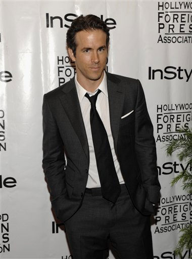 "<div class=""meta ""><span class=""caption-text "">People's Sexiest Man Alive 2010: Ryan Reynolds. Actor Ryan Reynolds arrives at the InStyle Hollywood Foreign Press Association  Toronto International Film Festival party in Toronto on Tuesday, Sept. 14, 2010.  (AP Photo/ Dan Steinberg)</span></div>"