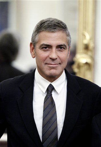People&#39;s Sexiest Man Alive 1997, 2006: George Clooney. In this Tuesday, Oct. 12, 2010 photo, actor George Clooney stands before his meeting with, Sen. Richard Lugar, R-Ind., on Capitol Hill in Washington. Actor George Clooney says he still gets a thrill when he meets with President Barack Obama _ but to his father that kind of thing is old hat. NOTE: Clooney has won the award twice. <span class=meta>(AP Photo&#47; Alex Brandon)</span>
