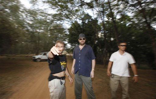 A bodyguard of British actor-comedian Russell Brand, left, points his finger at the photographer as a wedding guest, center, and another bodyguard look on after an assault on a group of news photographers at the Ranthambore National Park in Ranthambore, India, Friday, Oct. 22, 2010. Brand&#39;s friend and a bodyguard assaulted four news photographers, including one from The Associated Press, when they were taking pictures of the British comedian Friday in an Indian tiger reserve before his wedding to Katy Perry, the photographers said. The photographers had been following about 330 feet &#40;100 meters&#41; behind two jeeps, one carrying Brand, a woman who was not Perry, a man and two children, and the second carrying the bodyguard and another man later described by police as Brand&#39;s friend and wedding guest. &#40;AP Photo&#47; Mustafa Quraishi&#41; <span class=meta>(AP Photo&#47; Mustafa Quraishi)</span>