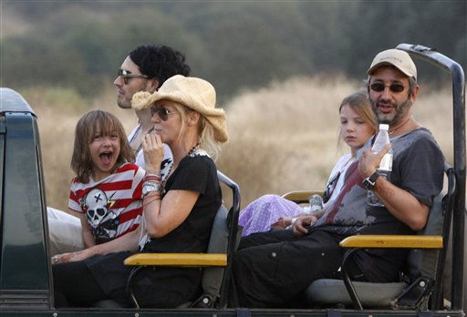 British actor-comedian Russell Brand, background left, sits with others on a jeep during a jungle safari at the Ranthambore National Park in Ranthambore, India, Friday, Oct. 22, 2010. Russell Brand&#39;s friend and a bodyguard assaulted four news photographers, including one from The Associated Press, when they were taking pictures of the British comedian Friday in an Indian tiger reserve before his wedding to Katy Perry, the photographers said. The photographers had been following about 330 feet &#40;100 meters&#41; behind two jeeps, one carrying Brand, a woman who was not Perry, a man and two children, and the second carrying the bodyguard and another man later described by police as Brand&#39;s friend and wedding guest. &#40;AP Photo&#47; Mustafa Quraishi&#41; <span class=meta>(AP Photo&#47; Mustafa Quraishi)</span>