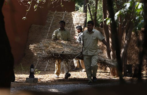 "<div class=""meta ""><span class=""caption-text "">Hotel staff set up temporary screens at the site for the wedding of British actor-comedian Russell Brand and Katy Perry in Ranthambore, India, Friday, Oct. 22, 2010. Russell Brand's friend and a bodyguard assaulted four news photographers, including one from The Associated Press, when they were taking pictures of the British comedian Friday in an Indian tiger reserve before his wedding to Katy Perry, the photographers said. The photographers had been following about 330 feet (100 meters) behind two jeeps, one carrying Brand, a woman who was not Perry, a man and two children, and the second carrying the bodyguard and another man later described by police as Brand's friend and wedding guest. (AP Photo/ Mustafa Quraishi) (AP Photo/ Mustafa Quraishi)</span></div>"