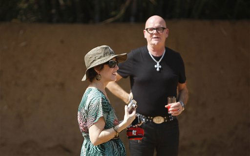 Mary Hudson, left, and Keith Hudson, parents of singer Katy Perry look on outside the venue for the wedding of their daughter to British actor-comedian Russell Brand, in Ranthambore, India, Friday, Oct. 22, 2010. Brand&#39;s friend and a bodyguard assaulted four news photographers, including one from The Associated Press, when they were taking pictures of the British comedian Friday in an Indian tiger reserve before his wedding to Katy Perry, the photographers said. The photographers had been following about 330 feet &#40;100 meters&#41; behind two jeeps, one carrying Brand, a woman who was not Perry, a man and two children, and the second carrying the bodyguard and another man later described by police as Brand&#39;s friend and wedding guest. &#40;AP Photo&#47; Mustafa Quraishi&#41; <span class=meta>(AP Photo&#47; Mustafa Quraishi)</span>