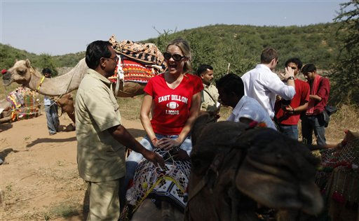 An unidentified guest rides a camel outside the venue for the wedding of British actor-comedian Russell Brand and Katy Perry in Ranthambore, India, Friday, Oct. 22, 2010. Brand&#39;s friend and a bodyguard assaulted four news photographers, including one from The Associated Press, when they were taking pictures of the British comedian Friday in an Indian tiger reserve before his wedding to Katy Perry, the photographers said. The photographers had been following about 330 feet &#40;100 meters&#41; behind two jeeps, one carrying Brand, a woman who was not Perry, a man and two children, and the second carrying the bodyguard and another man later described by police as Brand&#39;s friend and wedding guest. &#40;AP Photo&#47; Mustafa Quraishi&#41; <span class=meta>(AP Photo&#47; Mustafa Quraishi)</span>