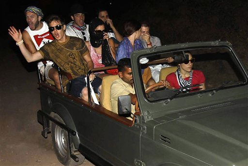 Unidentified guests gesture while traveling to the Aman e Khas hotel, a day after the wedding of Comedian Russell Brand and pop star Katy Perry  in Ranthambore, India, Sunday, Oct. 24, 2010. Brand and Perry were married Saturday in northwestern India, the couple confirmed in a statement. &#40;AP Photo&#41; <span class=meta>(AP Photo&#47; Anonymous)</span>