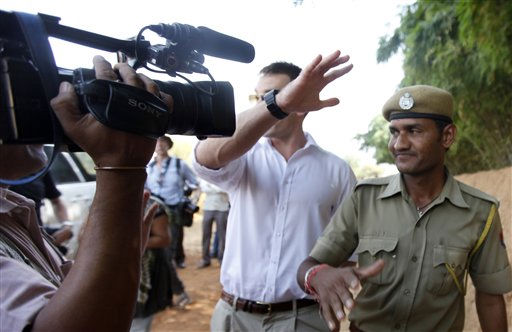 A British private security guard and an  Indian Home Guard block a news cameraman, outside the Aman e Khas hotel, a day after the wedding of Comedian Russell Brand and pop star Katy Perry  in Ranthambore, India, Sunday, Oct. 24, 2010. Brand and Perry were married Saturday in northwestern India, the couple confirmed in a statement. &#40;AP Photo&#47;Mustafa Quraishi&#41; <span class=meta>(AP Photo&#47; Mustafa Quraishi)</span>