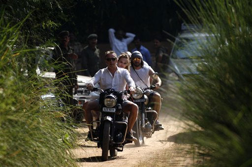 Unidentified guests leave the Sher Bagh jungle resort on motor bikes, a day after the wedding of Comedian Russell Brand and pop star Katy Perry  in Ranthambore, India, Sunday, Oct. 24, 2010. Brand and Perry were married Saturday in northwestern India, the couple confirmed in a statement. &#40;AP Photo&#47;Mustafa Quraishi&#41; <span class=meta>(AP Photo&#47; Mustafa Quraishi)</span>