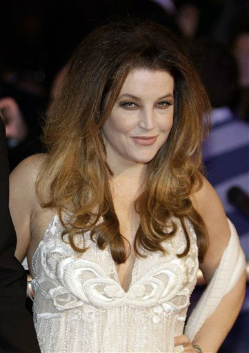 Lisa Marie Presley poses for the photographers as she attends the world premiere of the film&#39; Harry Potter and The Deathly Hallows&#39;,  at a cinema in central London, Thursday, Nov. 11, 2010.  She is one of the celebrities rumored to be dancing on the 14th season of &#39;Dancing with the Stars&#39; on ABC. The official cast will be revealed on February 28 on ABC. <span class=meta>(AP Photo&#47; Lefteris Pitarakis)</span>
