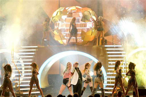 Ke&#36;ha, center left, and Pitbull, center right, perform on stage at the American Music Awards at the Nokia Theatre L.A. Live on Sunday, Nov. 24, 2013, in Los Angeles. &#40;Photo by John Shearer&#47;Invision&#47;AP&#41; <span class=meta>(Photo&#47;John Shearer)</span>