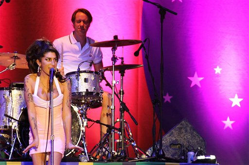 British artist Amy Winehouse, left, performs during her show in Florianopolis, Brazil, Saturday, Jan. 8, 2011. Winehouse played new material for the first time in nearly five years at her comeback show in Brazil.