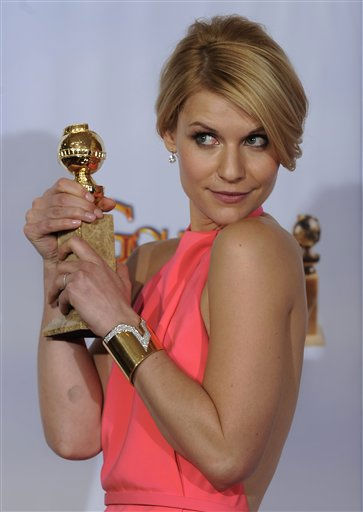 "<div class=""meta ""><span class=""caption-text "">Claire Danes holds the award she won for Best Performance by an Actress in a Mini-series or Motion Picture Made for Television for her role in ""Temple Grandin,"" at the Golden Globe Awards Sunday, Jan. 16, 2011, in Beverly Hills, Calif.  (AP Photo/ Mark J. Terrill)</span></div>"