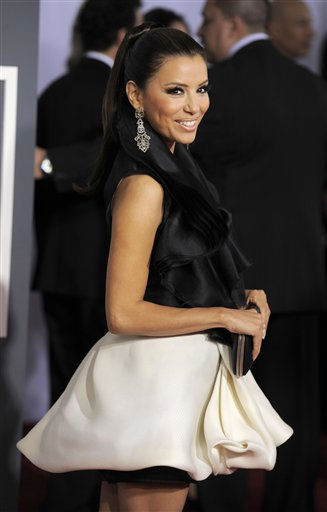 "<div class=""meta ""><span class=""caption-text "">Eva Longoria arrives at the 53rd annual Grammy Awards on Sunday, Feb. 13, 2011, in Los Angeles. (AP Photo/Chris Pizzello) (AP Photo/ Chris Pizzello)</span></div>"