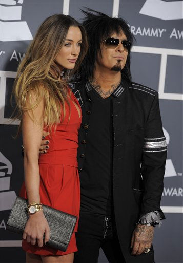 Nikki Sixx, right, and guest arrive at the 53rd annual Grammy Awards on Sunday, Feb. 13, 2011, in Los Angeles. &#40;AP Photo&#47;Chris Pizzello&#41; <span class=meta>(AP Photo&#47; Chris Pizzello)</span>