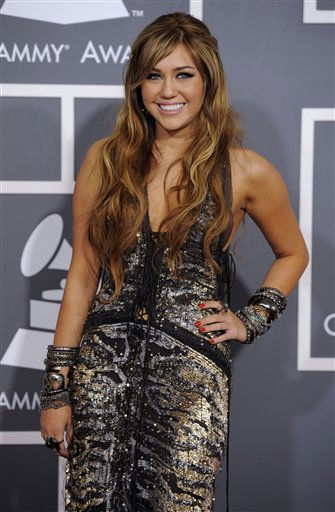 Miley Cyrus arrives at the 53rd annual Grammy Awards on Sunday, Feb. 13, 2011, in Los Angeles. &#40;AP Photo&#47;Chris Pizzello&#41; <span class=meta>(AP Photo&#47; Chris Pizzello)</span>